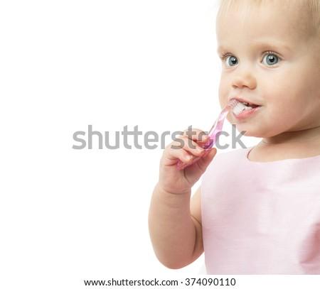 little child baby brushing teeth brush face isolated on white studio shot - stock photo