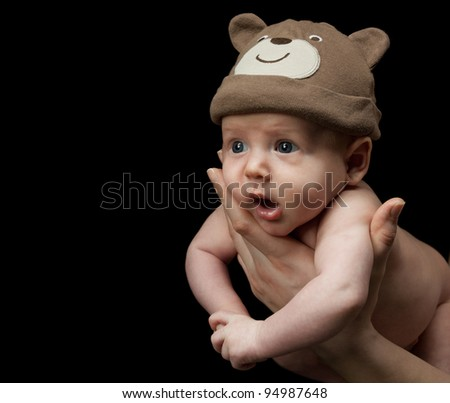 little child baby on black background - stock photo
