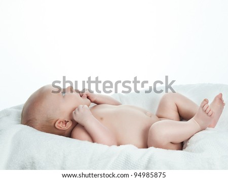 little child baby on white towel - stock photo