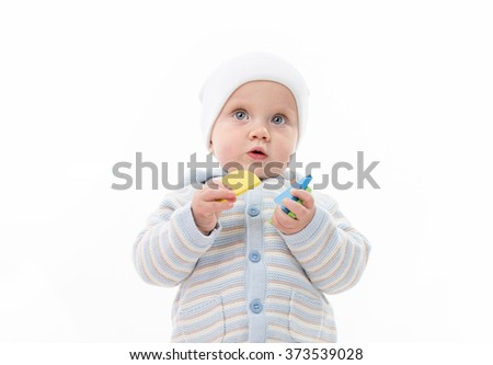 little child baby playing with puzzles isolated on white studio shot - stock photo