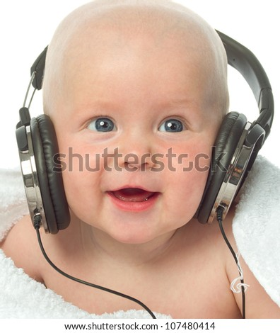 little child baby smiling closeup portrait isolated on white studio shot face positive happy listening music headphones - stock photo