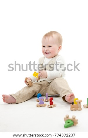 little child baby smiling  isolated on white studio shot siiting playing with numbers count