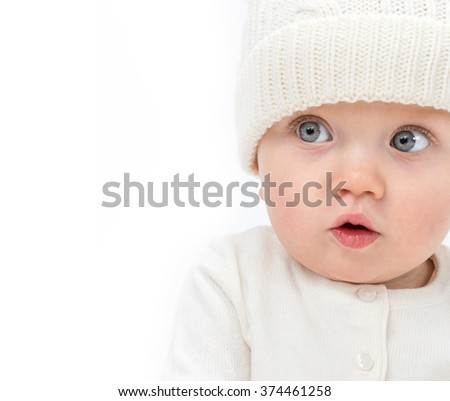 little child baby smiling  warm clothing hat isolated on white studio shot  - stock photo