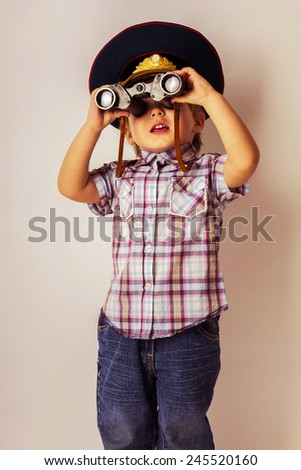 Little child boy looking binoculars lens isolated - stock photo
