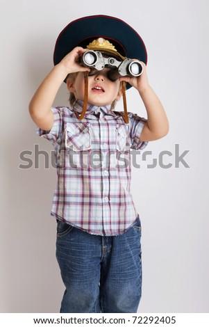 Little child boy looking binoculars lens isolated - stock photo