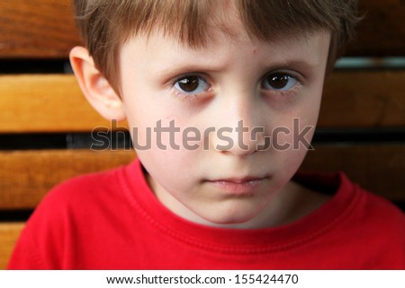 Little child boy looking seriously - stock photo