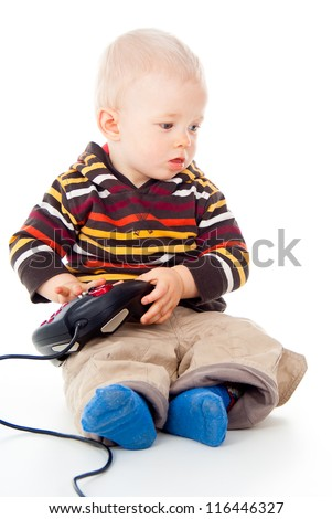 little child boy plays with a joystick
