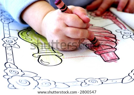 little child coloring in coloring book with crayons - Coloring Book Crayons