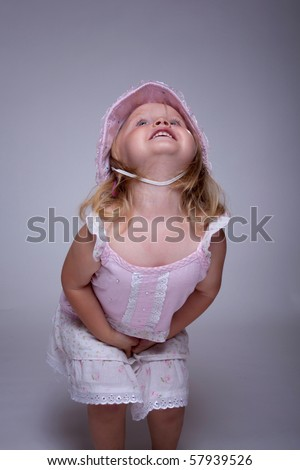 Little child crying because of a stomach ache - stock photo