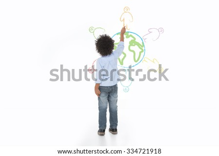 little child drawing a world on the wall, he want the peace  - stock photo
