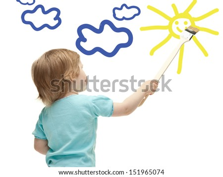Little child drawing sun with a paintbrush - stock photo