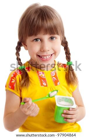 Little child eating yogurt - stock photo