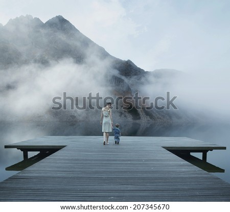 Little child exploring the world with his mother - stock photo