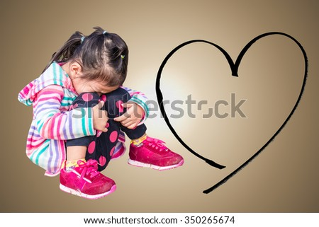 little child girl crying thinking about family - stock photo