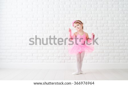 little child girl dreams of becoming  ballerina in a pink tutu skirt  - stock photo