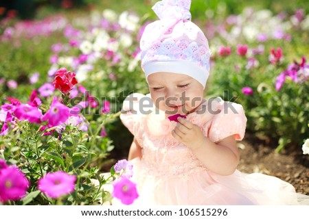 Little child girl enjoy flower