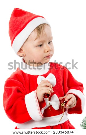 Little child girl in Santa costume on white background. X-mas, winter, happiness concept