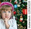 Little child girl near Christmas tree. Happy new year - stock