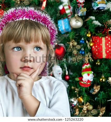 Little child girl near Christmas tree. Happy new year - stock photo