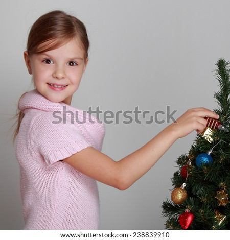 Little child girl near Christmas tree/Happy new year - stock photo