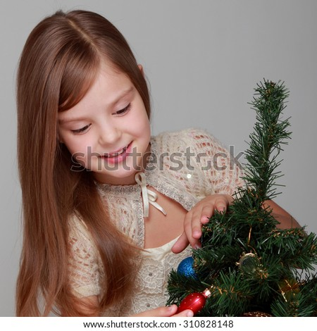 Little child girl near Christmas tree/Happy new year - stock photo