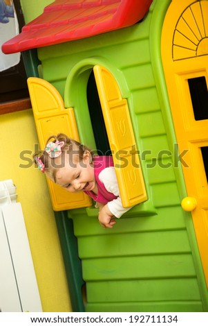 Little child girl playing in kindergarten in Montessori preschool Class. - stock photo