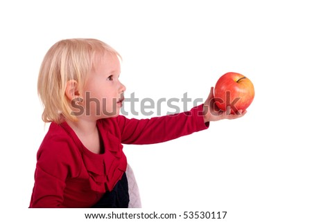 little child gives somebody a big apple