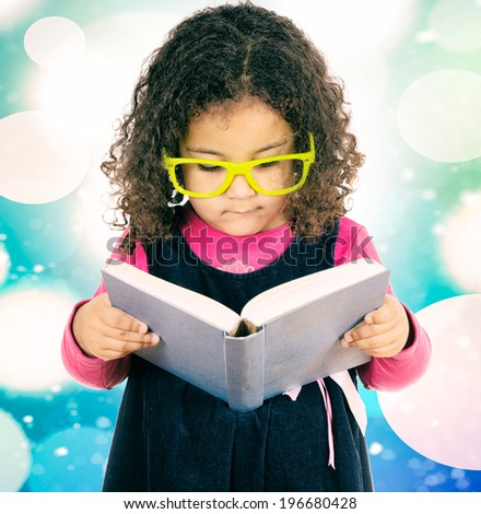Little child holding the book and reading  - stock photo