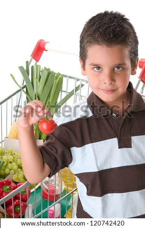 Little child holding tomatoes - stock photo