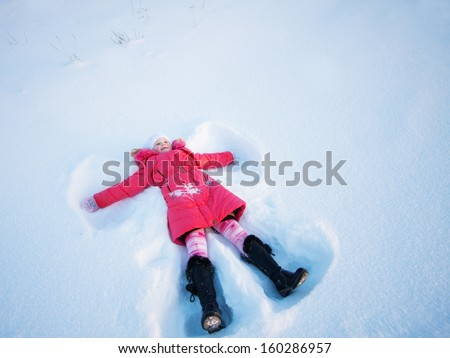 Little child in a clear white snow