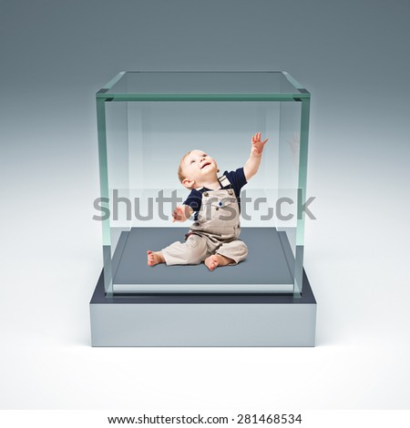 little child in glass box - stock photo