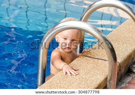 Little child in the swimming pool - stock photo