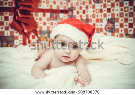 Little child in x-mas cap. Happy New 2017 Year