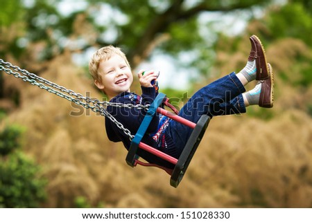Little child on swing - stock photo