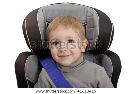 Little child on vehicle car safety seat with belt - stock photo
