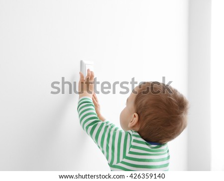 Little child playing with switch - stock photo