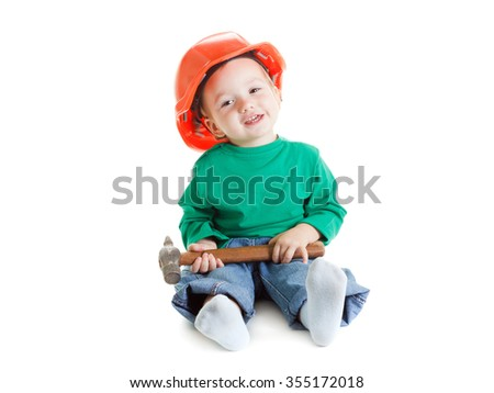 Little child plays with hammer and orange construction protective helmet  on white background. Profession future builder. - stock photo