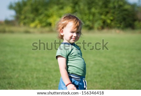 little child posing on the field