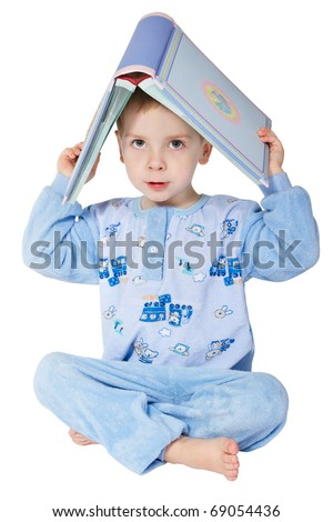 Little child reading book. Book as roof. Legs crossed. Over white background.