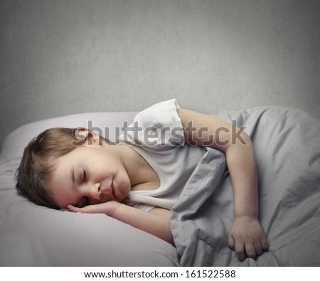 little child sleeping well - stock photo