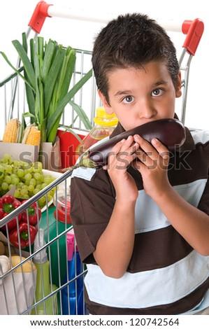 Little child smelling eggplant - stock photo