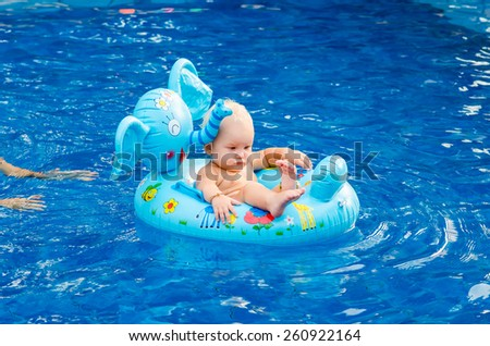 Little child swimming in the pool - stock photo