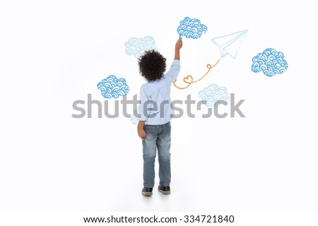 little child thinking about the future and painting on white wall - stock photo