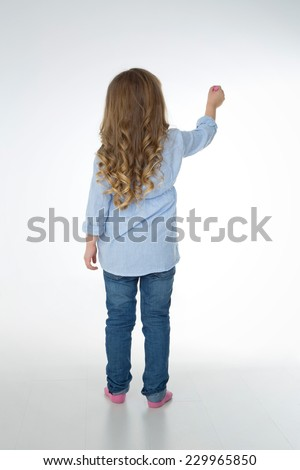 little child thinks about what to represent - stock photo