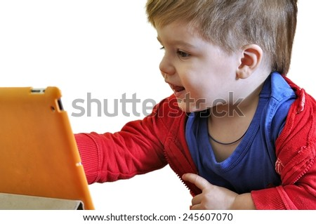 Little child using a tablet PC isolated - stock photo