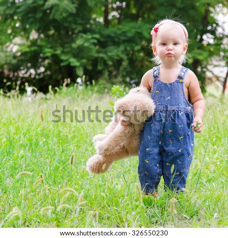 Little child with a teddy bear in his hands - stock photo
