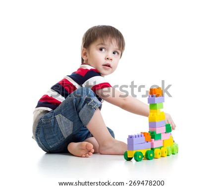 little child with construction set over white background