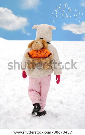 little child with funny rucksack on the back ,going alone in winter outside