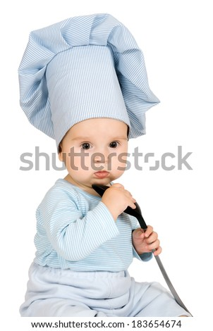 Little child with metal ladle and cook hat as a cook against white background - stock photo