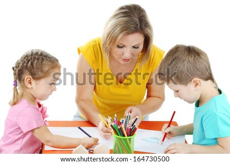 Little children drawing with mom isolated on white - stock photo